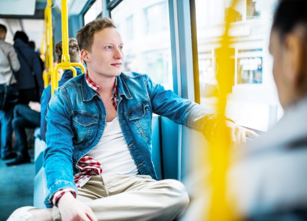 Young man on a bus.